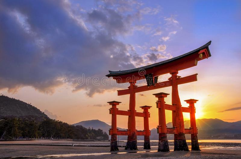 Great torii of Miyajima at sunset, near Hiroshima Japan. Great torii of Miyajima at sunset, near Hiroshima, Japan stock image