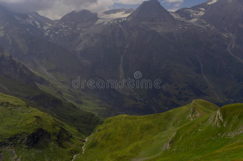 Great view of the alpine green mountains. stock photos