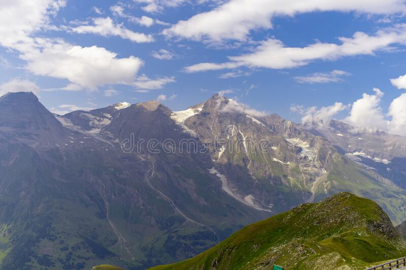 Great view of the alpine green mountains. stock photo