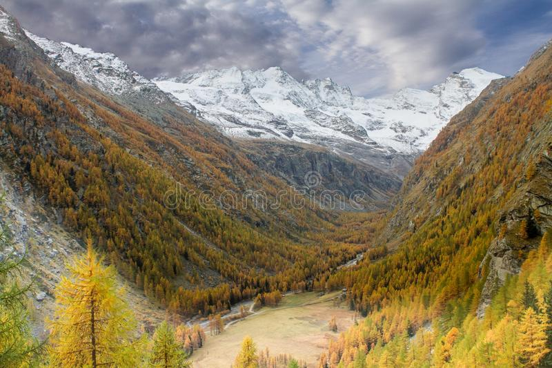 Great view of valley in Gran Paradiso National Park, Alps, Italy, dramatic scene, beautiful world. colourful autumn and mountain. S covered by snow,scenic view stock photos