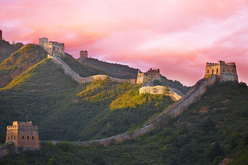 Beijing Great Wall, China. Sunset rainbow of Great Wall with orange atmosphere, Simatai section, Beijing, China stock photo