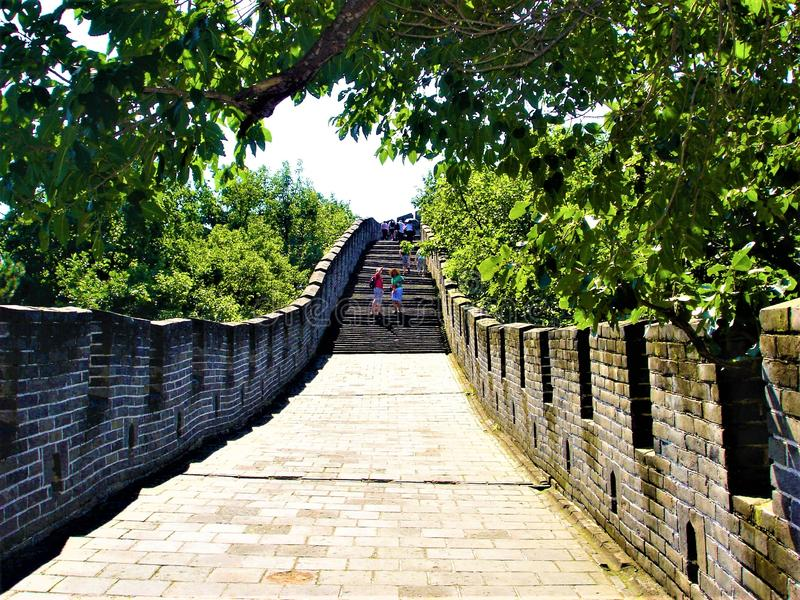 The Great Wall of China, tourists and nature. The Great Wall of China is the collective name of a series of fortification systems generally built across the stock photo