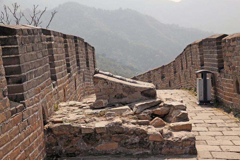Great Wall of China. Mutianyu. Old gun. Mutianyu (Chinese: 慕田峪; pinyin: Mùtiányù) is a section of the Great Wall of China located in stock photos