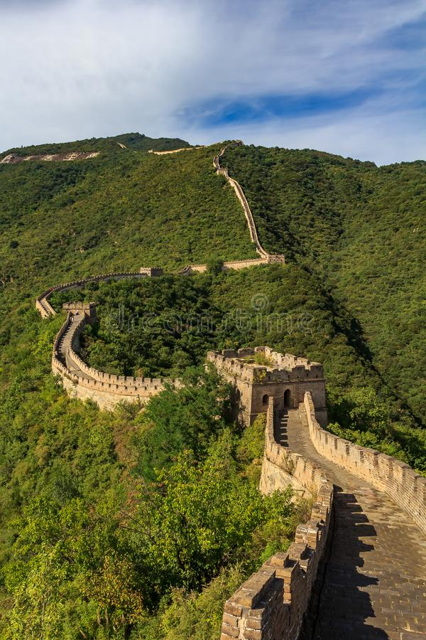 Great Wall of China, in the Mutianyu village, one of remote parts of the Great Wall near Beijing. The Great Wall of China, in the Mutianyu village, one of remote stock image