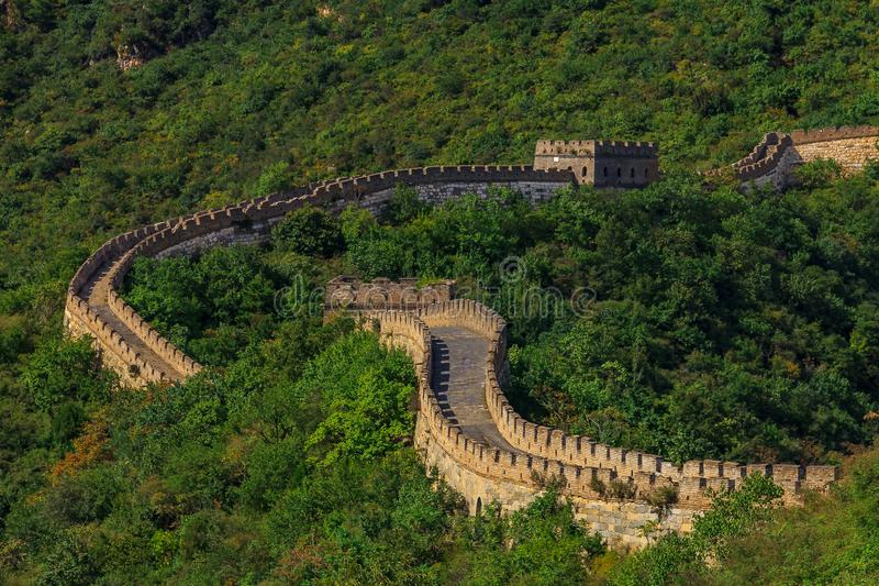 Great Wall of China, in the Mutianyu village, one of remote parts of the Great Wall near Beijing. The Great Wall of China, in the Mutianyu village, one of remote royalty free stock photography