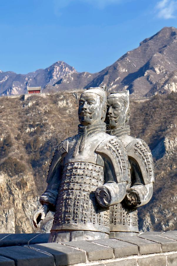 The Great Wall of China in winter. sculptures of ancient warriors on the background of the great wall. The Badaling area. China famous landmark. wonders of the stock photos