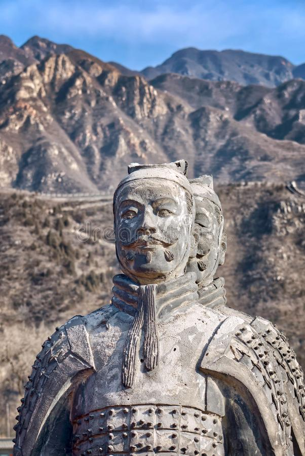 The Great Wall of China in winter. sculptures of ancient warriors on the background of the great wall. The Badaling area. China famous landmark. wonders of the royalty free stock photography