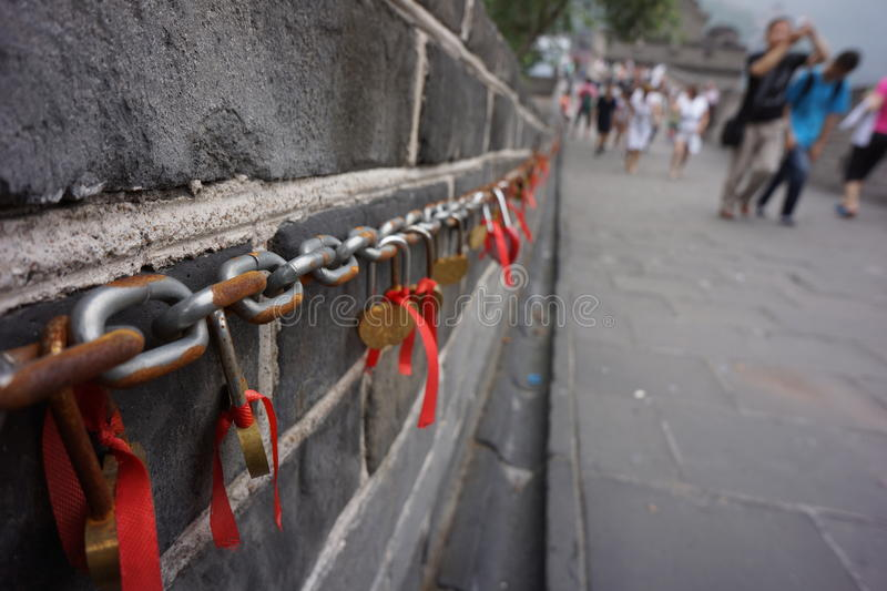 The Great Wall Love Locks, Beijing China. No one knows how or when this ancient Chinese custom began, but the lock-laden chains, common in the Yellow Mountains stock photography