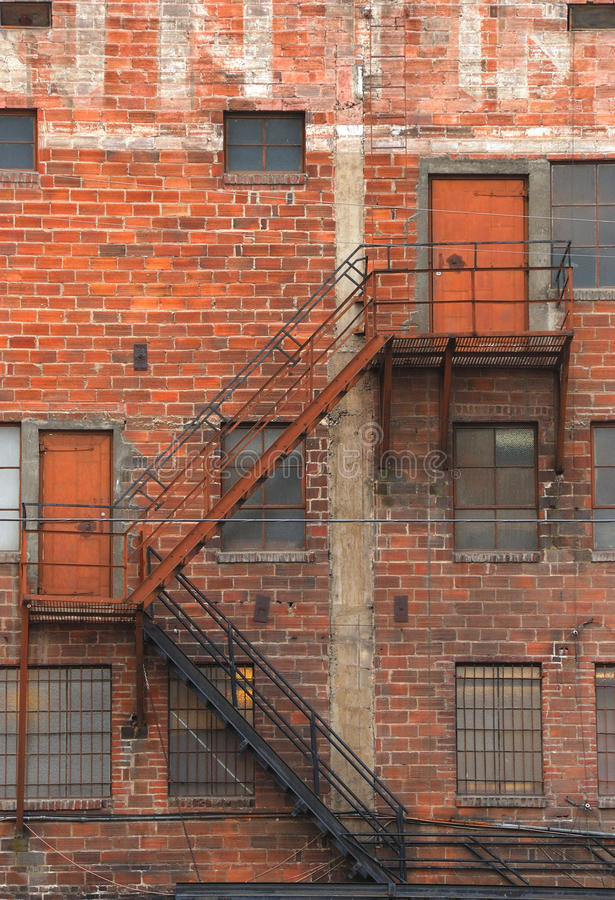 Great Wall. Old fire escape on a large brick industrial building in central Washington state stock image