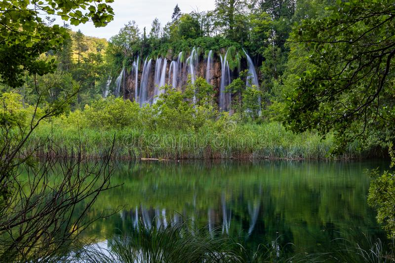 Great waterfall with reflection in Plitvice Lakes National Park. Croatia stock image