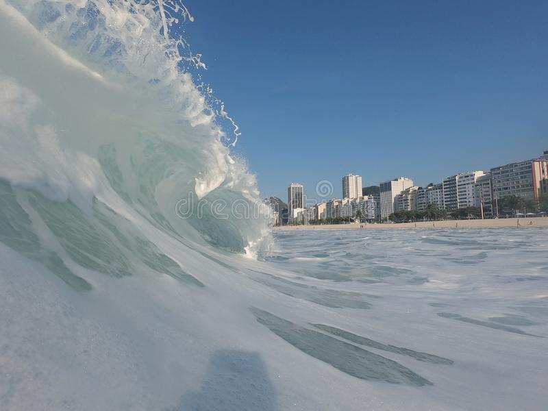 Great wave crest in Rio. Amazing sunny day with a Incredible wave crest in the shorebreak of Leme's beach,  Rio de Janeiro  - Brazil, lemes stock photography