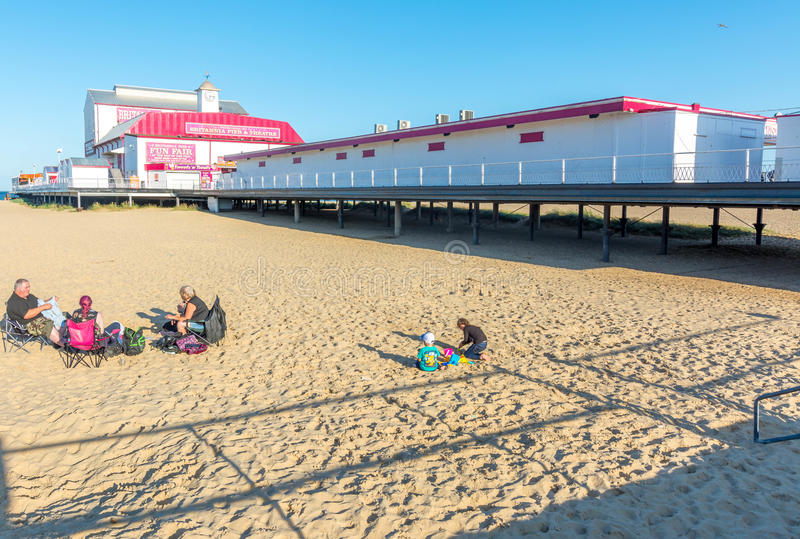 Great Yarmouth in England. Great Yarmouth, England - August 17, 2017: Marine Parade is situated on the Great Yarmouth coastline in East Anglia. Bustling pier royalty free stock photography