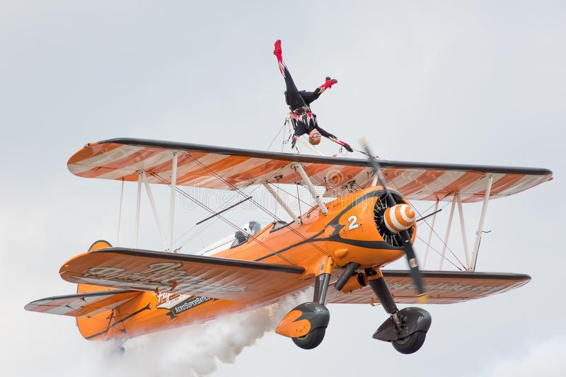 Biplane of Aerosuperbatics aerobatic wingwalker display team at stock photography