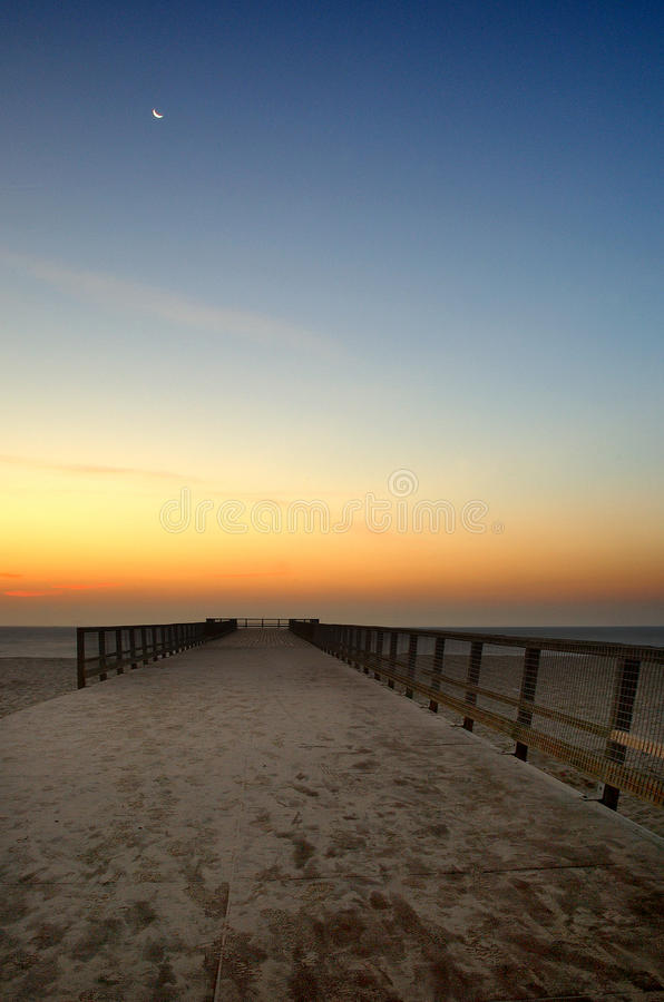 Great Yarmouth Pier Early Dawn. This is a Pier in Great Yarmouth United Kingdom England Norfolk East Anglia. Early morning sunrise over the seafront and sand stock photos