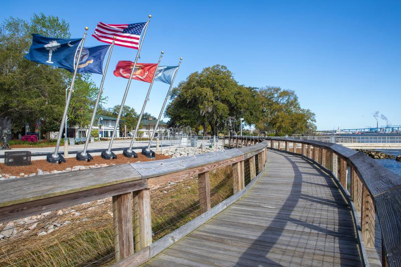 Greater Charleston SC Naval Base Memorial Boardwalk. Boardwalk around the five lighted flagpoles featuring flags of the United States, South Carolina, North stock image