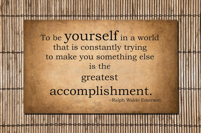 The greatest accomplishment - Emerson quote stock photo