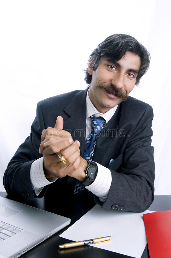 Greatful Manager. An appreciative manager at his desk royalty free stock photography