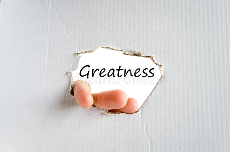 Greatness text concept. Isolated over white background stock photos