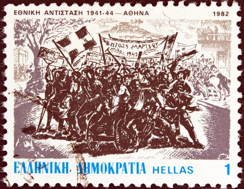 GRECJA - CIRCA 1982: Pieczęć wydrukowana w Grecji pokazuje demonstrację w Atenach, 25 marca 1942 r. Zachariou, ok. 1982 fotografia stock