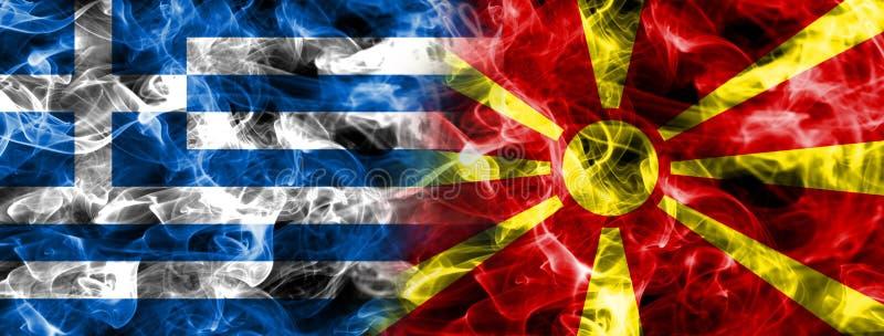 Grecja i Macedonia dymu flaga zdjęcia royalty free