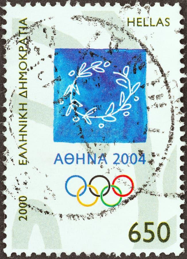 GRECJA - OKOŁO 2000: Znaczek drukujący w Grecja pokazuje emblemat i Olimpijskich pierścionki około 2000, obrazy royalty free