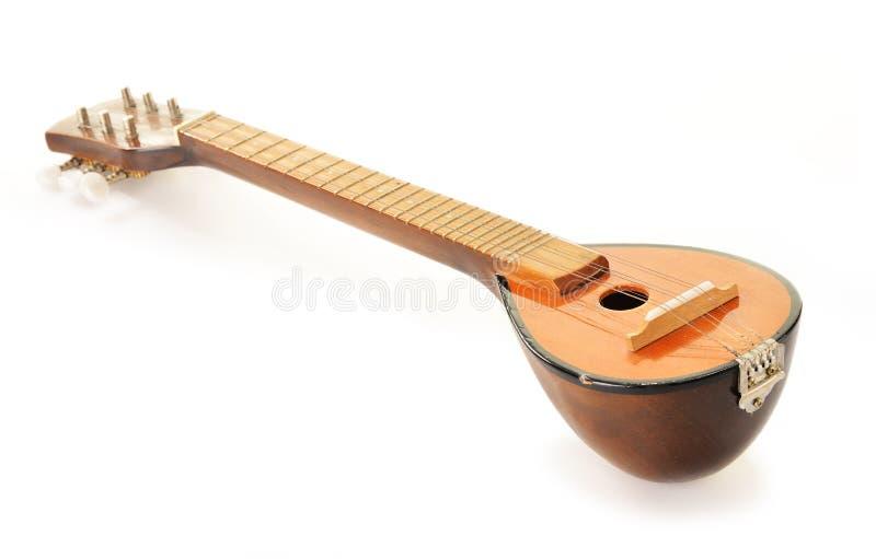 Grecki instrument muzyczny bouzouki na bielu zdjęcie royalty free