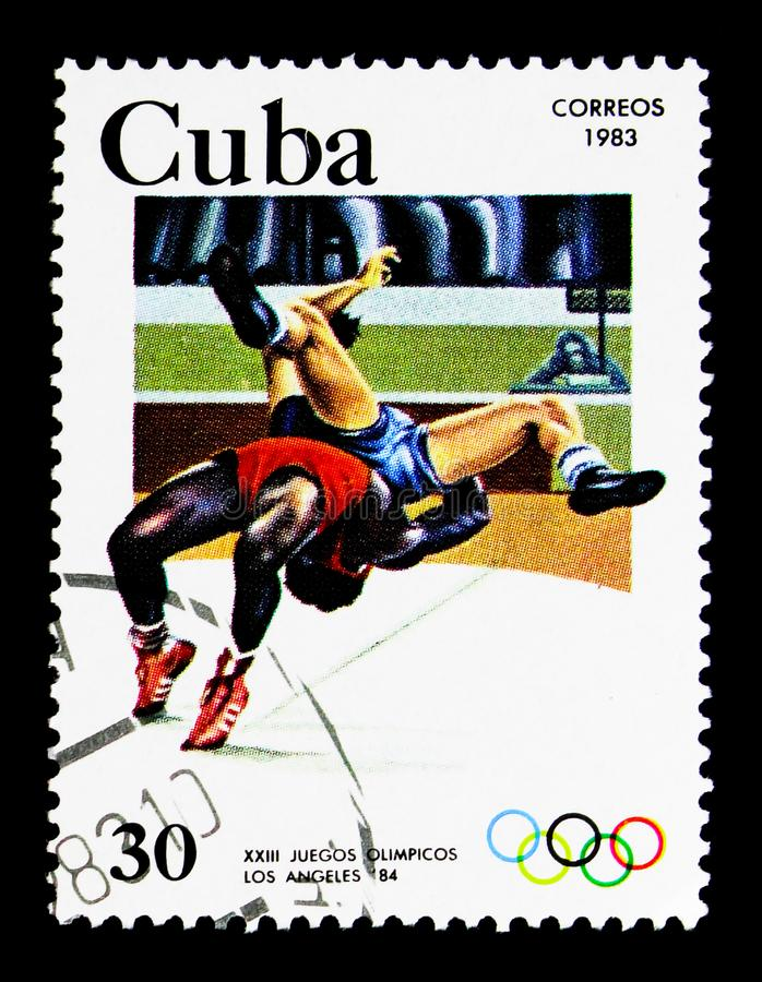 Greco-Roman wrestling, Los Angeles Olympic games - 84, serie, circa 1983. MOSCOW, RUSSIA - NOVEMBER 25, 2017: A stamp printed in Cuba shows Greco-Roman wrestling stock photography