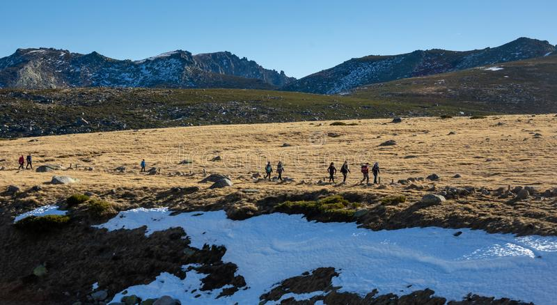 Gredos, Spain. 12-January-2019. Horizontal picture of group of trekkers in the mountains during a sunny winter day royalty free stock images