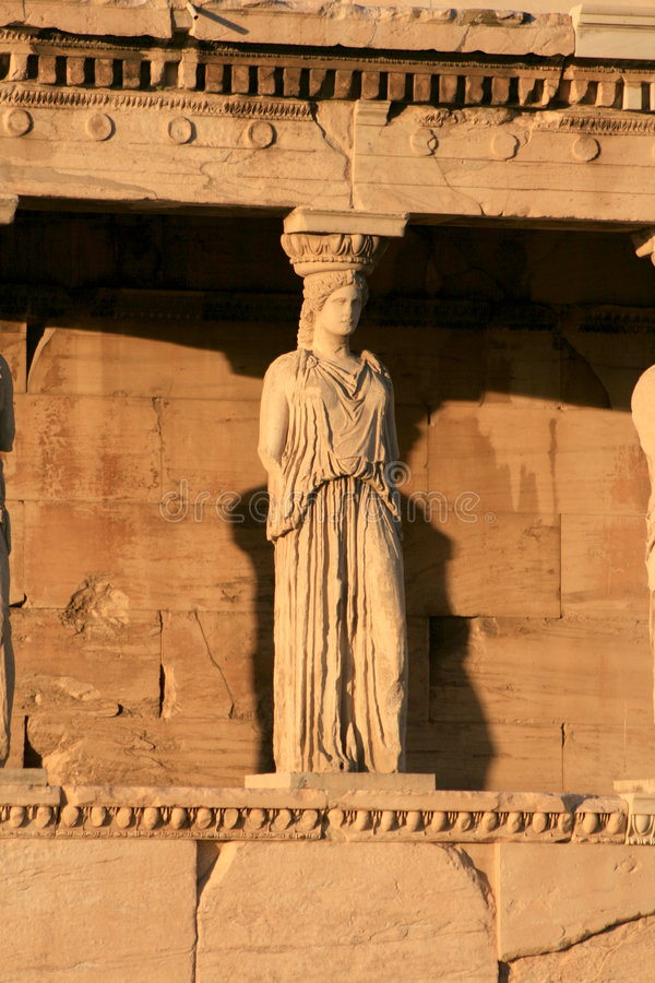Greece. Athens, Greece - Caryatids, sculpted female figures, used as columns to hold portion of the roof of the erechtheum. Located on the north side of the stock photo