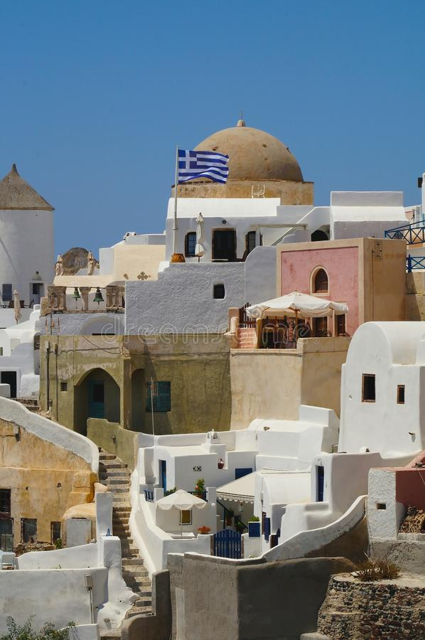 That is Greece. Ancient traditional buildings in Oia town of Santorini island, Greece royalty free stock image