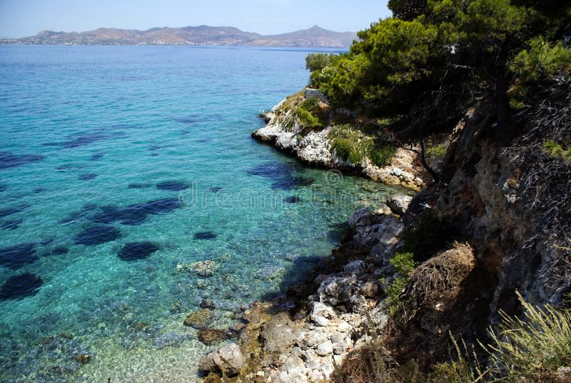 Greece, Angistri, near Athens.  Crystal clear waters. Greece, the island of Angistri, near Athens.  Crystal clear water. Rocky pine covered cliffs.  In the royalty free stock photos