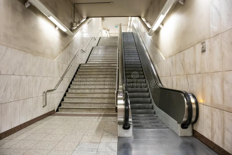 Greece, Athens. Electric escalators and stairway at a metro station in the city center royalty free stock photos