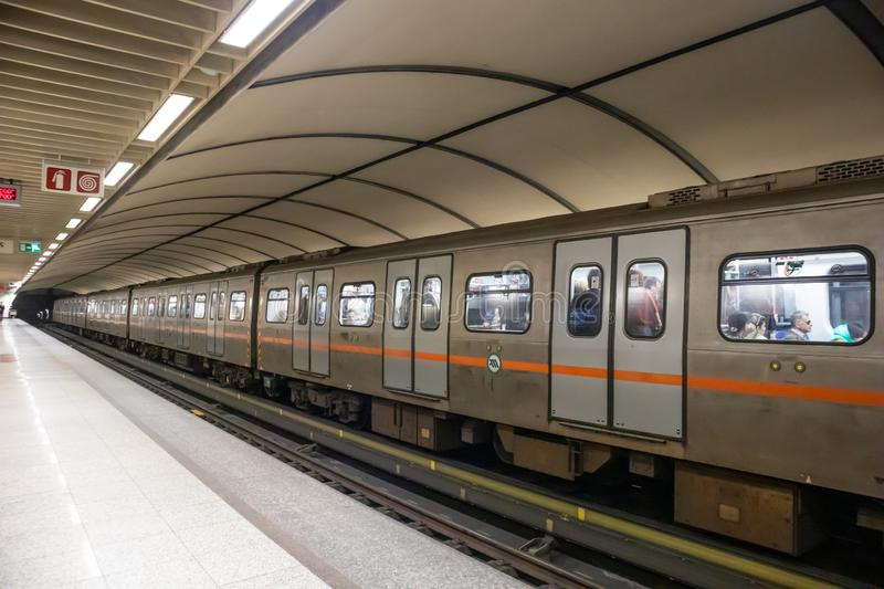 Greece, Athens. Metro station at the city center. Train with passengers, empty platform royalty free stock photo