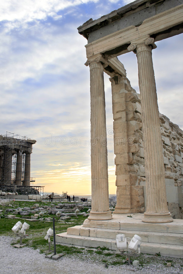 Greece, Athens - Parthenon and Erechtheum. Athens, Greece - View of the Erechtheum, temple on the north side of the Acropolis dedicated to Athena and Poseidon royalty free stock images