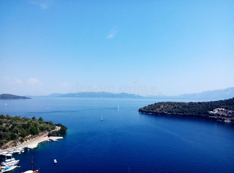 Greece bay with ships and boats stock images