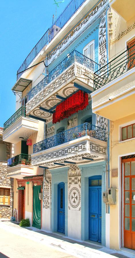 Greece, Chios, Pyrgi, red tomatoes under a blue white balcony stock photography