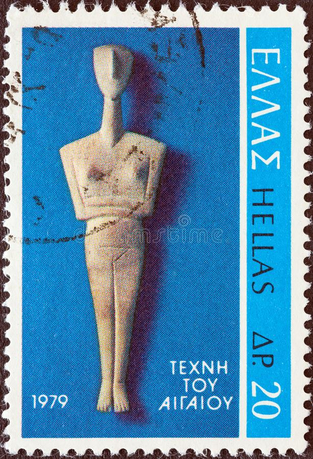 GREECE - CIRCA 1979: A stamp printed in Greece shows Cycladic Figure from Amorgos island, circa 1979. royalty free stock image