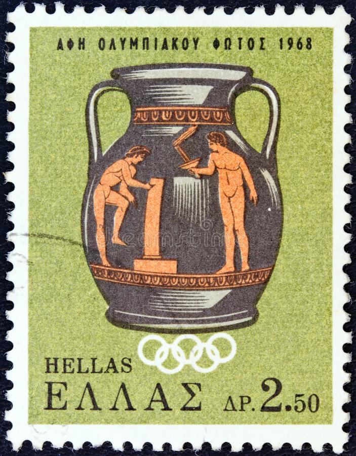 GREECE - CIRCA 1968: A stamp printed in Greece shows an Olympic scene on Attic vase, circa 1968. royalty free stock photo