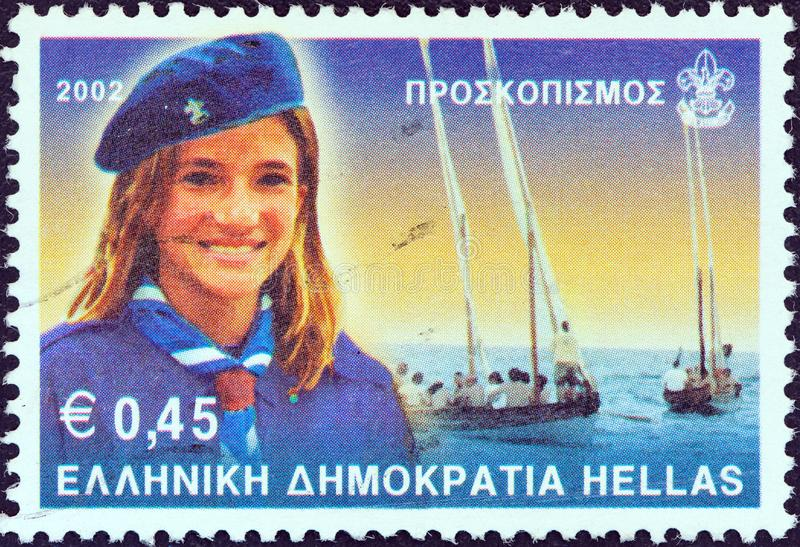 GREECE - CIRCA 2001: A stamp printed in Greece shows Navy scout girl, circa 2001. GREECE - CIRCA 2001: A stamp printed in Greece from the `Scouting ` issue royalty free stock images