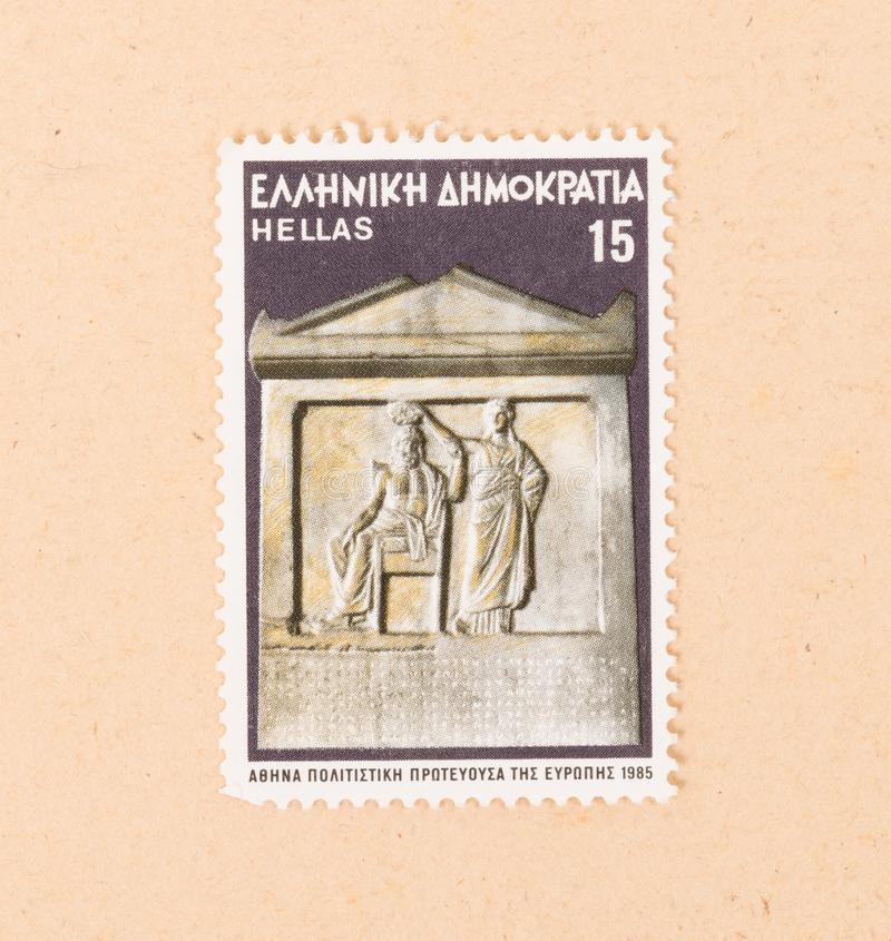 A stamp printed in Greece shows a statue on a building, circa 1985 royalty free stock photos