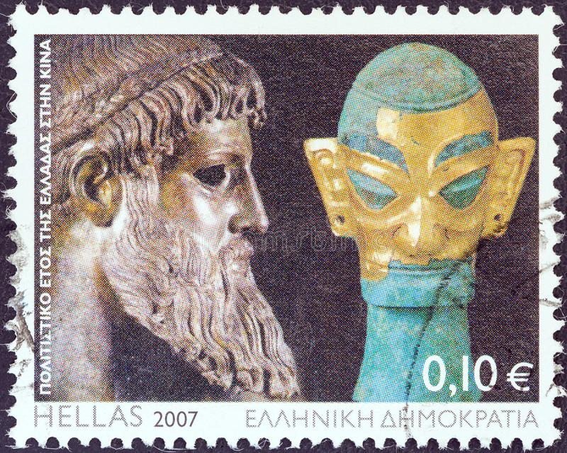 GREECE - CIRCA 2007: A stamp printed in Greece shows Zeus of Artemision statue and bronze head sculpture with golden mask. royalty free stock photos