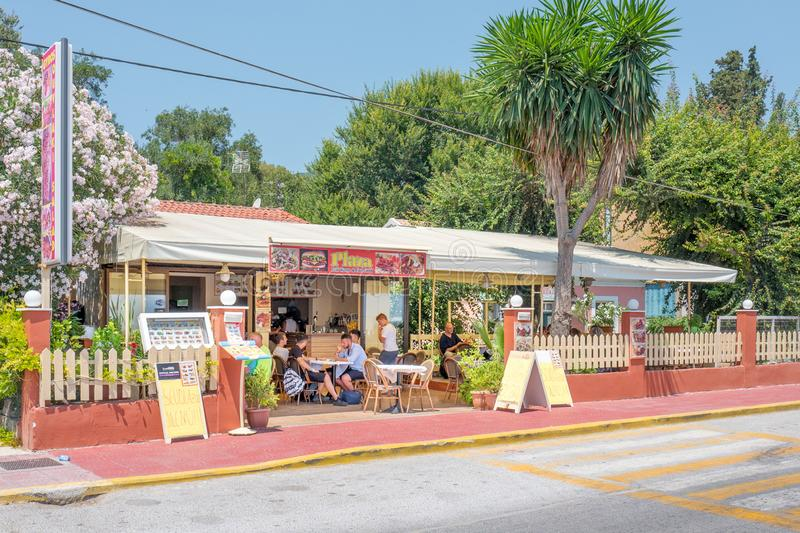 Plaza Grill House & Fast Food restaurant in Ipsos town on Corfu, Greece royalty free stock photography