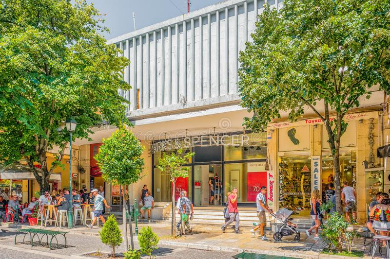 People before the Marks & Spencer store in Corfu Town Kerkyra in Greece royalty free stock image