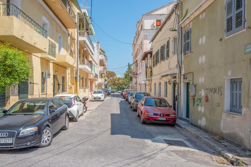 Street with houses, apartments and parked cars in Corfu Town Kerkyra in Greece stock images