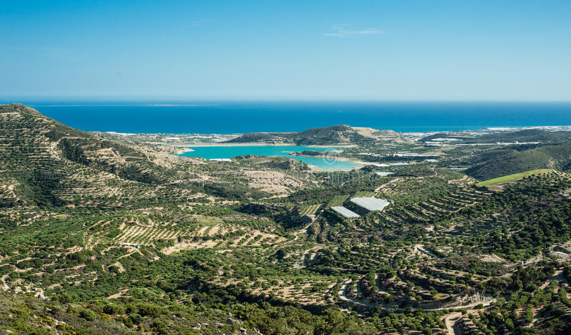 Greece, Crete, view to the green hills and sea, olives trees and royalty free stock image