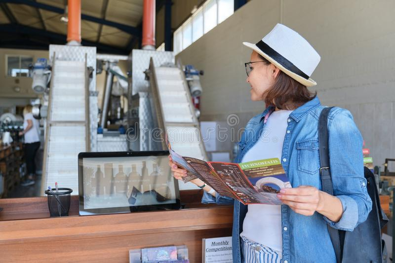 Greece, Crete, 09-09-2019. Woman with tourist advertisement in an olive factory.  stock photo