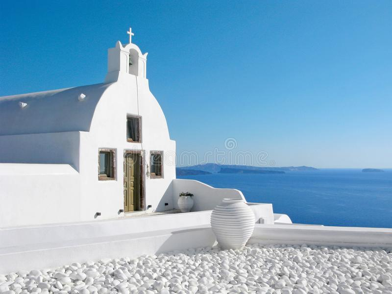 Greece, Santorini, white church over the sea, Cycladic architecture royalty free stock images