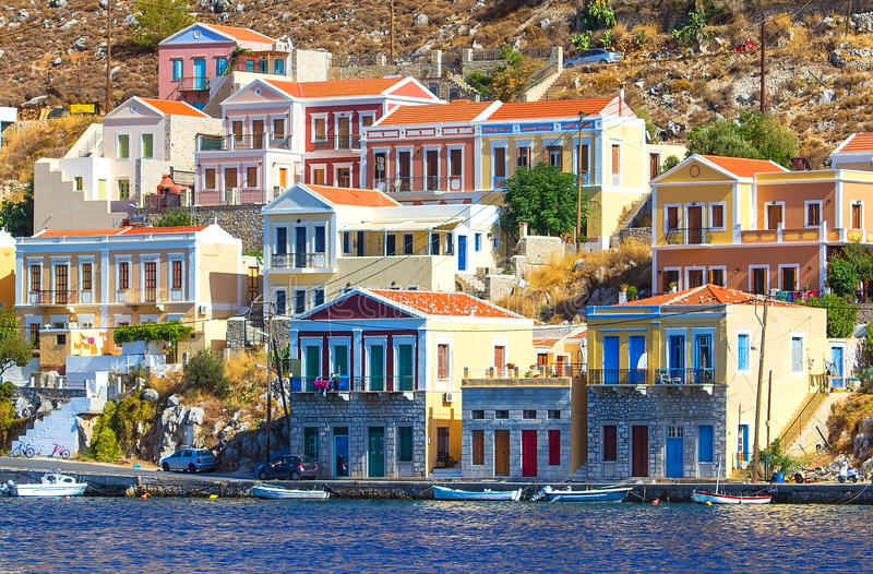 Greece. Dodecanesse. Island Symi Simi . Colorful houses on rocks stock images