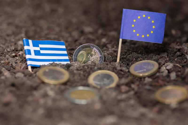 Greece and the EC. Greece sinking into earth together with the eruo royalty free stock photos