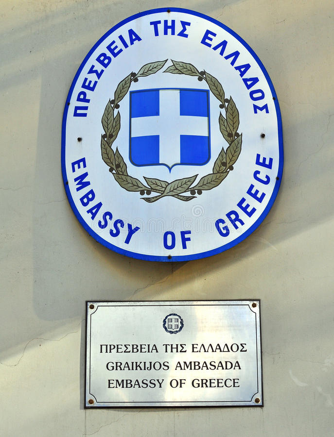 Greece Embassy sign. VILNIUS, LITHUANIA - APRIL 12: Sign and flag of Greek Embassy in Vilnius downtown on April 12, 2015. Greece is a country located in royalty free stock image